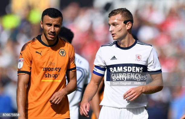 Romain Saiss of Wolverhampton Wanderers and Ben Gibson of Middlesborough wearing protective face mask during the Sky Bet Championship match between...