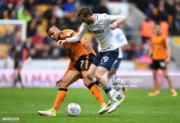 Romain Saiss of Wolverhampton Wanderers and Tom Barkhuizen of Preston North End during the Sky Bet Championship match between Wolverhampton and...