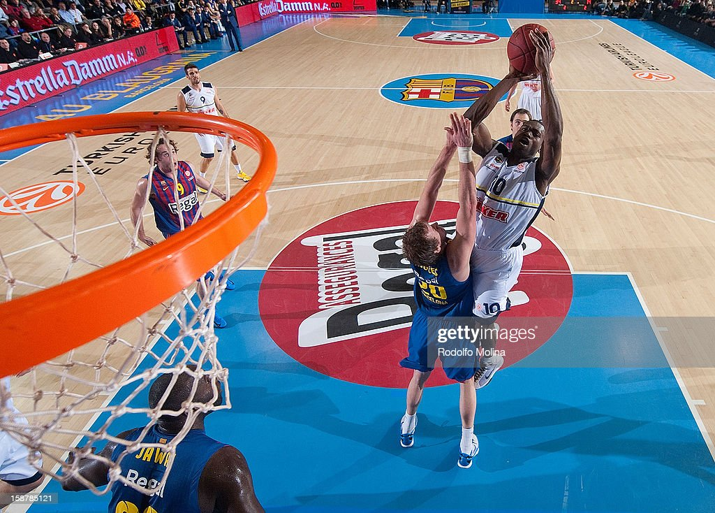 Romain Sato, #10 of Fenerbahce Ulker Istanbul competes with Joe Ingles, #20 of FC Barcelona Regal during the 2012-2013 Turkish Airlines Euroleague Top 16 Date 1 between FC Barcelona Regal v Fenerbahce Ulker Istanbul at Palau Blaugrana on December 28, 2012 in Barcelona, Spain.
