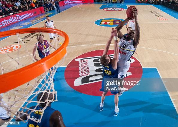 Romain Sato #10 of Fenerbahce Ulker Istanbul competes with Joe Ingles #20 of FC Barcelona Regal during the 20122013 Turkish Airlines Euroleague Top...