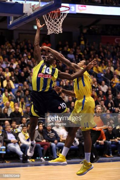 Romain Sato #10 of Fenerbahce Ulker Istanbul competes with Malcom Thomas of Maccabi Electra Tel Aviv during the 20122013 Turkish Airlines Euroleague...
