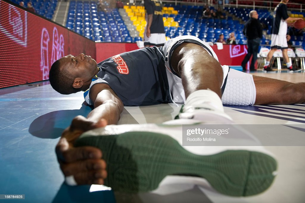 Romain Sato, #10 of Fenerbahce Ulker Istanbul streching before the 2012-2013 Turkish Airlines Euroleague Top 16 Date 1 between FC Barcelona Regal v Fenerbahce Ulker Istanbul at Palau Blaugrana on December 28, 2012 in Barcelona, Spain.