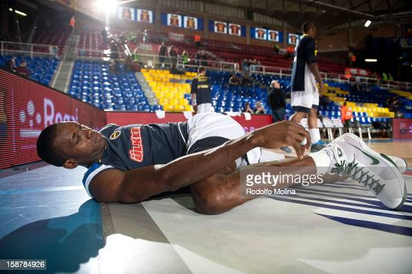 Romain Sato #10 of Fenerbahce Ulker Istanbul streching before the 20122013 Turkish Airlines Euroleague Top 16 Date 1 between FC Barcelona Regal v...