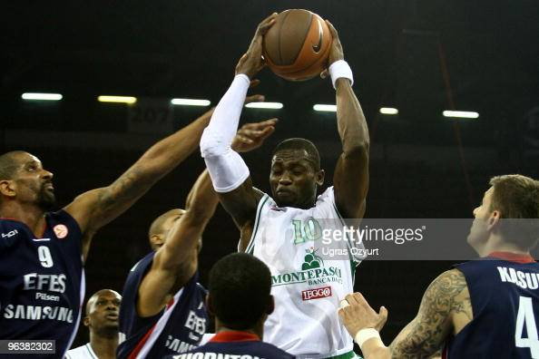 Romain Sato #10 of Montepaschi Siena competes with and Preston Shumpert #9 of Efes Pilsen Istanbul competes with and Mario Kasun #4 of Efes Pilsen...