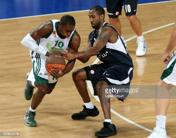 Romain Sato #10 of Panathinaikos Athens competes with Bootsy Thornton #11 of Efes Pilsen Istanbul during the 20102011 Turkish Airlines Euroleague...