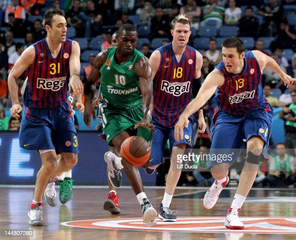 Romain Sato #10 of Panathinaikos Athens competes with Kosta Perovic #13 of FC Barcelona Regal during the Turkish Airlines EuroLeague Final Four Third...