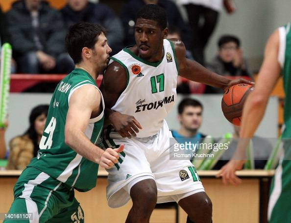 Romain Sato #10 of Panathinaikos Athens competes with Mike Wilkinson #54 of Unics Kazan during 20112012 Turkish Airlines Euroleague TOP 16 Game Day 6...