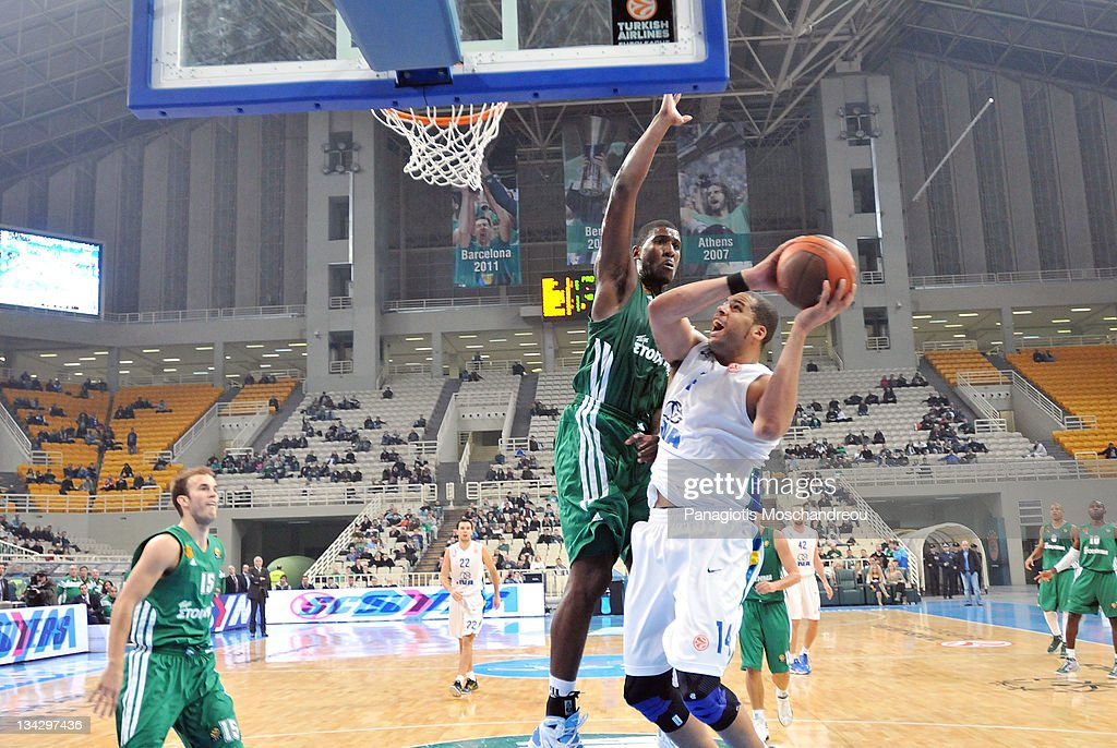 <a gi-track='captionPersonalityLinkClicked' href=/galleries/search?phrase=Romain+Sato&family=editorial&specificpeople=220873 ng-click='$event.stopPropagation()'>Romain Sato</a>, #10 of Panathinaikos Athens competes with Sean Gregory May, # 14 of KK Zagreb during the 2011-2012 Turkish Airlines Euroleague Regular Season Game Day 7 between Panathinaikos Athens v KK Zagreb Croatia Osiguranje at OAKA on November 30, 2011 in Athens, Greece.