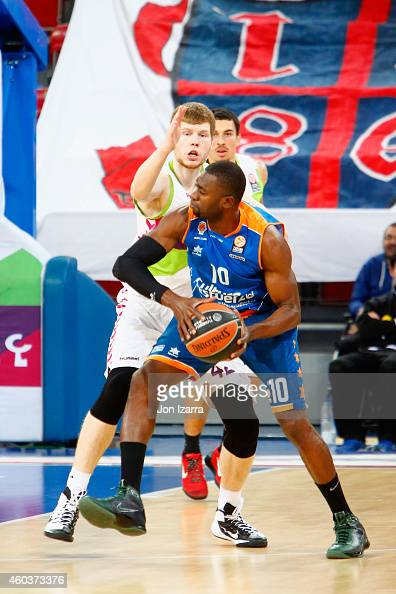Romain Sato #10 of Valencia Basket competes with Davis Bertans #42 of Laboral Kutxa Vitoria during the 20142015 Turkish Airlines Euroleague...