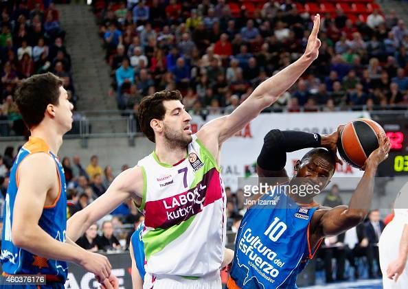 Romain Sato #10 of Valencia Basket competes with Tornike Shengelia #7 of Laboral Kutxa Vitoria during the 20142015 Turkish Airlines Euroleague...