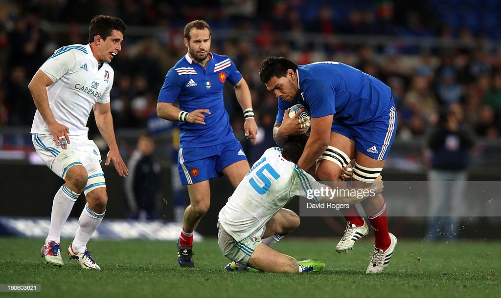 Romain Taofifenua of France is tackled by <a gi-track='captionPersonalityLinkClicked' href=/galleries/search?phrase=Andrea+Masi&family=editorial&specificpeople=572361 ng-click='$event.stopPropagation()'>Andrea Masi</a> during the RBS Six Nations match between Italy and France at Stadio Olimpico on February 3, 2013 in Rome, Italy.