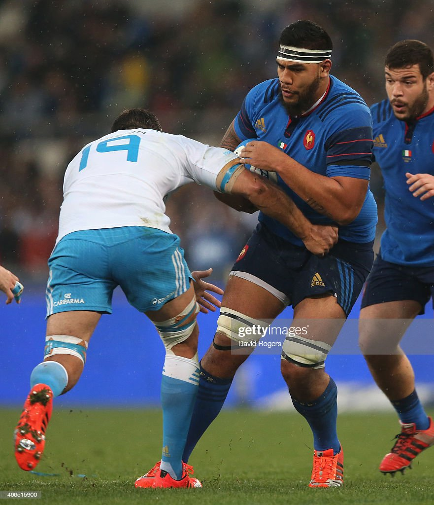 Romain Taofifenua of France is tackled by Quintin Geldenhuys during the Six Nations match between Italy and France at the Stadio Olimpico on March 15, 2015 in Rome, Italy.