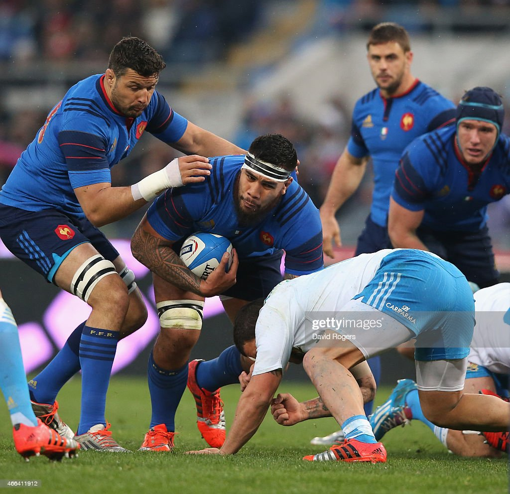 Romain Taofifenua of France is tackled by Samuela Vunisai during the Six Nations match between Italy and France at the Stadio Olimpico on March 15, 2015 in Rome, Italy.