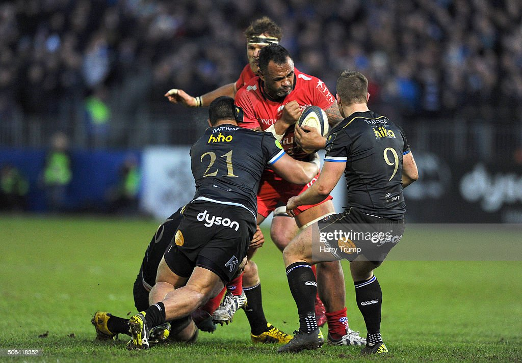 Romain Taofifenua of Toulon is tackled by Alafoti Faosiliva of Bath during the European Rugby Champions Cup match between Bath Rugby and RC Toulon at the Recreation Ground on January 23, 2016 in Bath, England.