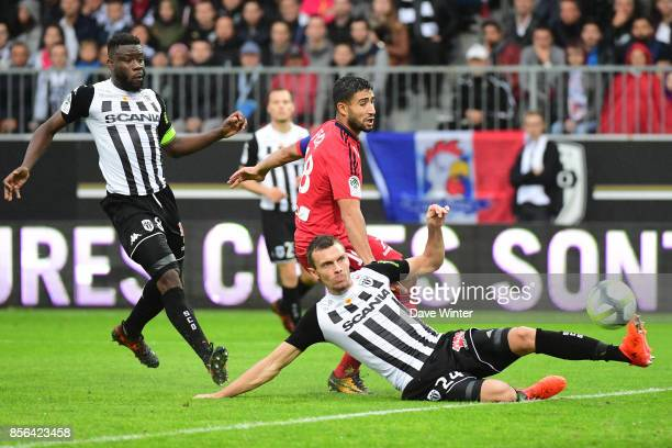 Romain Thomas of Angers and Nabil Fekir of Lyon during the Ligue 1 match between Angers SCO and Olympique Lyonnais at Stade Raymond Kopa on October 1...