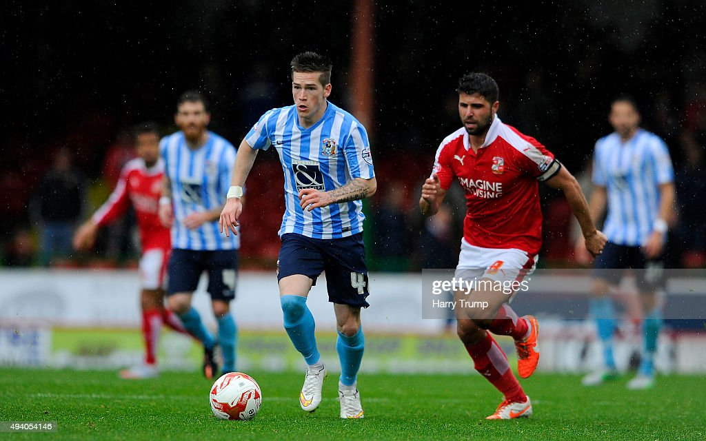 Romain Vincelot of Coventry City is tackled by Yaser Kasim of Swindon Town during the Sky Bet League One match between Swindon Town and Coventry City...