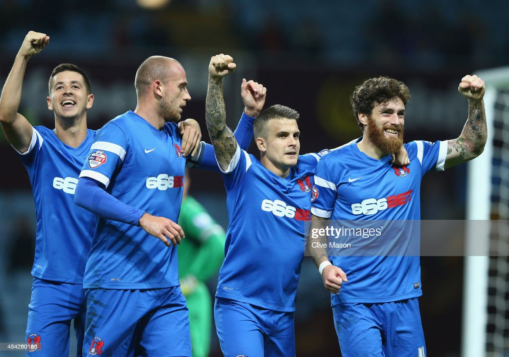 Romain Vincelot of Leyton Orient (right)celebrates his goal with his team mates during the Capital One Cup second round match between Aston Villa and Leyton Orient at Villa Park on August 27, 2014 in Birmingham, England.