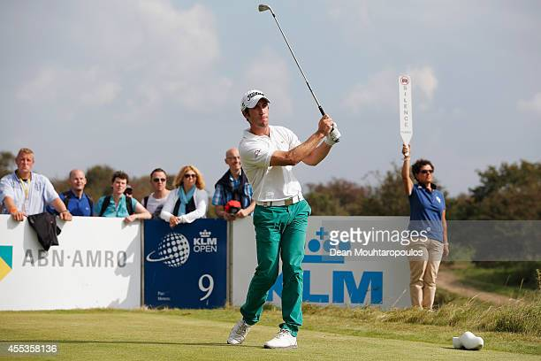 Romain Wattel France hits his tee shot on the 9th hole during Day 3 of the KLM Open held at De Kennemer Golf and Country Club on September 13 2014 in...