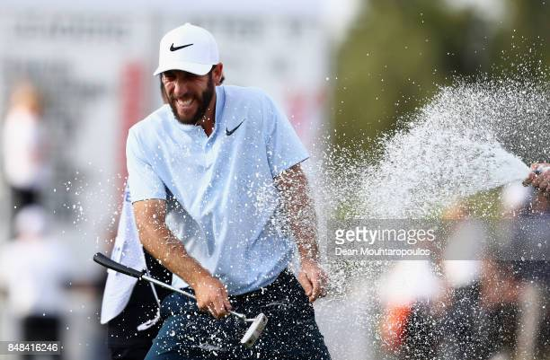 Romain Wattel of France celebrates winning the trophy on the 18th hole during Day Four of the KLM Open at The Dutch on September 17 2017 in Spijk...