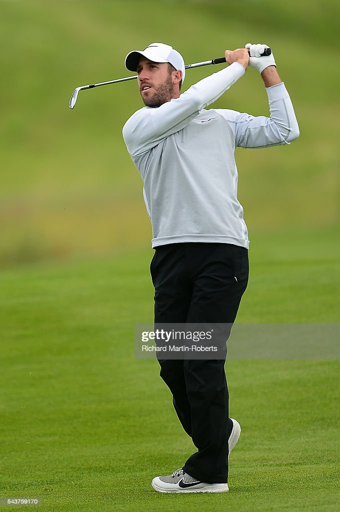 <a gi-track='captionPersonalityLinkClicked' href=/galleries/search?phrase=Romain+Wattel&family=editorial&specificpeople=5507914 ng-click='$event.stopPropagation()'>Romain Wattel</a> of France hits an approach shot during the first round of the 100th Open de France at Le Golf National on June 30, 2016 in Paris, France.