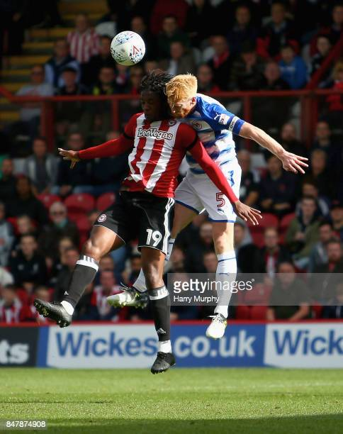 Romaine Sawyers of Brentford and Paul McShane of Reading battle for possession during the Sky Bet Championship match between Brentford and Reading at...