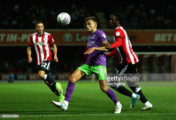 Romaine Sawyers of Brentford closes down Jamie Paterson of Bristol City during the Sky Bet Championship match between Brentford and Bristol City at...