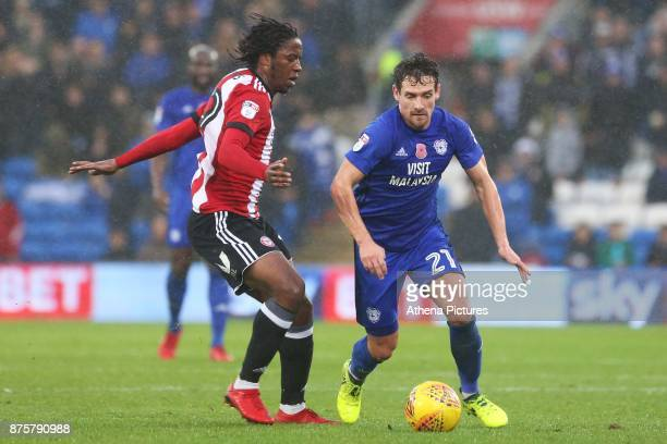 Romaine Sawyers of Brentford is tackled by Craig Bryson of Cardiff City during the Sky Bet Championship match between Cardiff City and Brentford at...