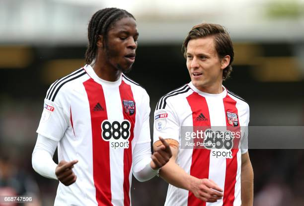 Romaine Sawyers of Brentford speaks with Lasse Vibe of Brentford during hald time in the Sky Bet Championship match between Brentford and Derby...