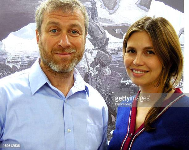 Roman Abramovich Russian billionaire and owner of Chelsea Football Club Ltd left and his girlfriend Dasha Zhukova attend Art Basel in Hong Kong China...