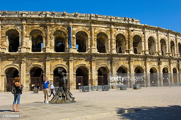 Roman amphitheatre and bullfighter statue Arenes Nimes Gard BouchesDuRhone France