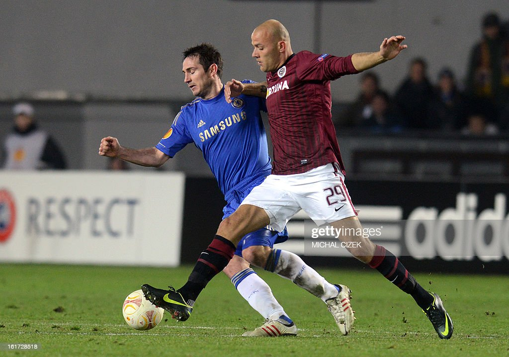 Roman Bednar of Sparta Praha (R) vies for a ball with Frank Lampard of Chelsea FC during the UEFA Europa League football match AC Sparta Praha vs Chelsea FC on February 14, 2013 in Prague, Czech Republic.