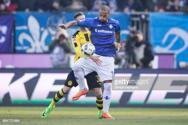 Roman Bezjak of Darmstadt is challenged by Dzenis Burnic of Dortmund during the Bundesliga match between SV Darmstadt 98 and Borussia Dortmund at...