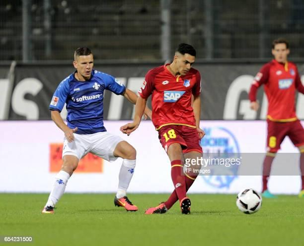 Roman Bezjak of Darmstadt Nadiem Amiri of Hoffenheim battle for the ball during the Bundesliga match between SV Darmstadt 98 and TSG 1899 Hoffenheim...