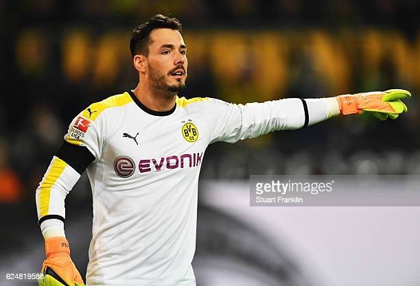 Roman Bürki of Dortmund points during the Bundesliga match between Borussia Dortmund and Bayern Muenchen at Signal Iduna Park on November 19 2016 in...