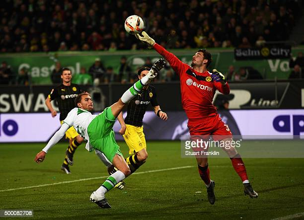 Roman Bürki of Dortmund saves a shot by Bas Dost of Wolfsburg during the Bundesliga match between VfL Wolfsburg and Borussia Dortmund at Volkswagen...