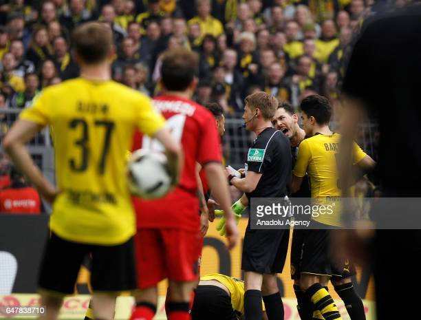 Roman Buerki of Borussia Dortmund argues with Referee Christian DIngert during the Bundesliga soccer match between Borussia Dortmund and Bayer 04...