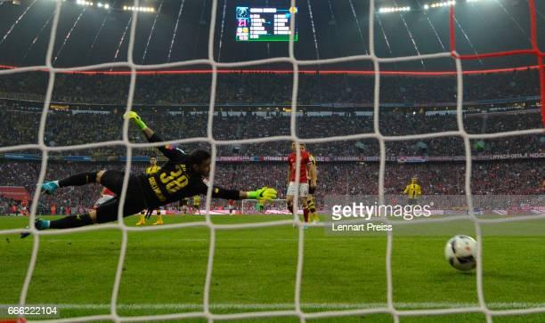 Roman Buerki of Borussia Dortmund can't save a shot of Arjen Robben of FC Bayern for the third goal of Bayern Munich during the Bundesliga match...