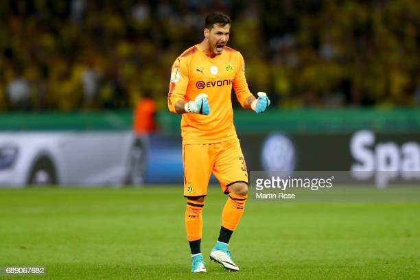 Roman Buerki of Dortmund celebrates his team's second goal during the DFB Cup final match between Eintracht Frankfurt and Borussia Dortmund at...