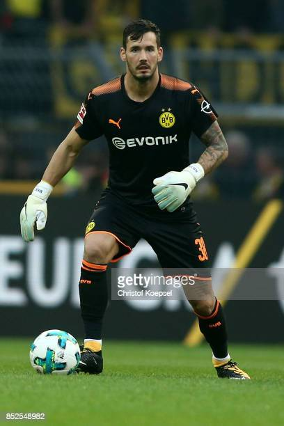 Roman Buerki of Dortmund runs with the ball during the Bundesliga match between Borussia Dortmund and Borussia Moenchengladbach at Signal Iduna Park...