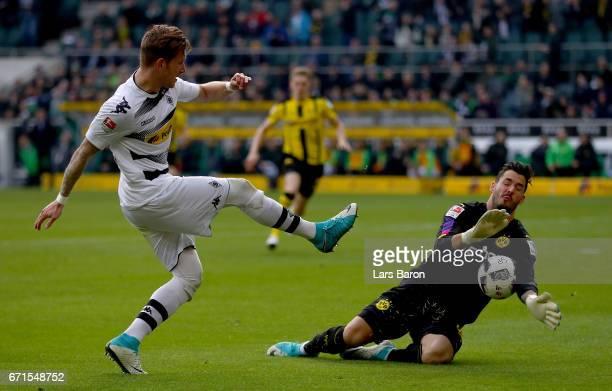 Roman Buerki of Dortmund saves a shot of Andre Hahn of Moenchengladbach during the Bundesliga match between Borussia Moenchengladbach and Borussia...