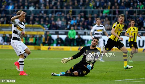 Roman Buerki of Dortmund saves a shot of Patrick Herrmann of Moenchengladbach during the Bundesliga match between Borussia Moenchengladbach and...