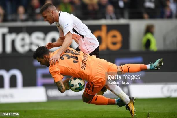 Roman Buerki of Dortmund saves against Ante Rebic of Frankfurt during the Bundesliga match between Eintracht Frankfurt and Borussia Dortmund at...