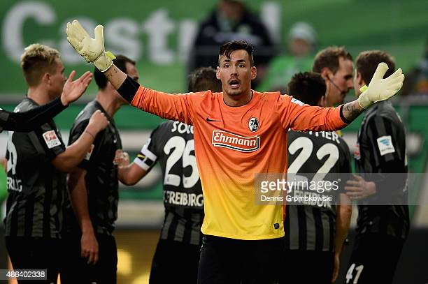 Roman Buerki of SC Freiburg reacts as he takes down Kevin De Bruyne of VfL Wolfsburg during the Bundesliga match between VfL Wolfsburg and SC...