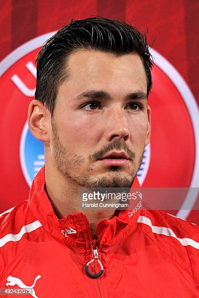 Roman Buerki of Switzerland looks on during the anthem prior to the UEFA EURO 2016 qualifier between Switzerland and San Marino at AFG Arena on...