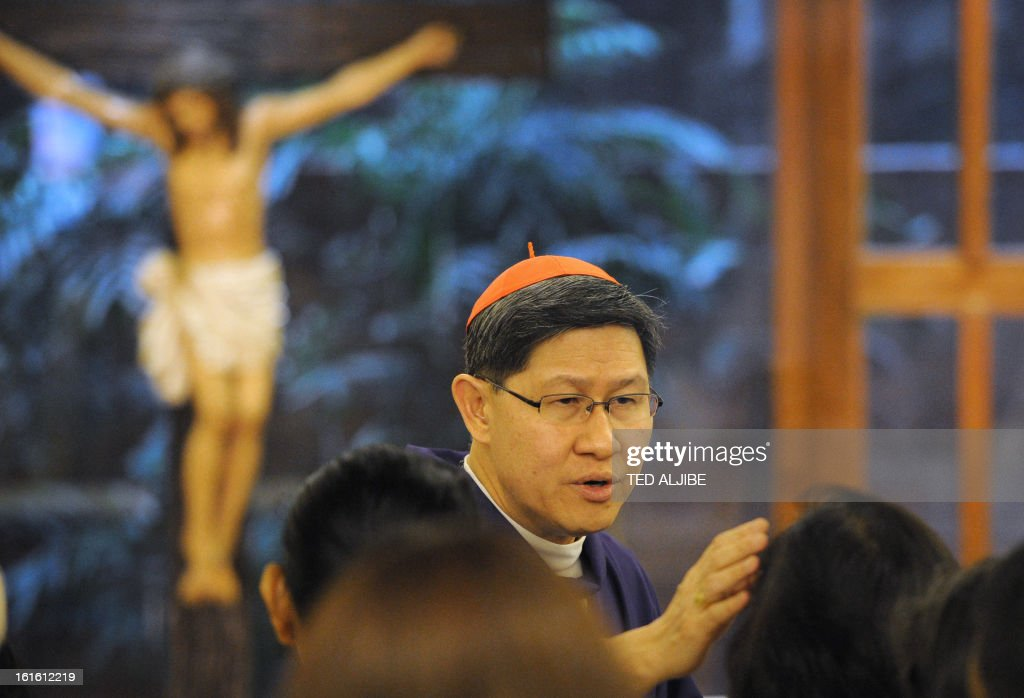 Roman Catholic Archbishop of Manila Cardinal Luis Antonio Tagle applies ash on the faithfuls during an Ash Wednesday mass at a church in Manila on...