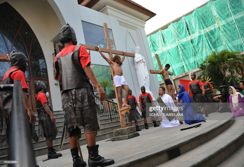 Roman Catholic devotee perform to mark Easter during Good Friday in Kuta on Indonesia's resoret island of Bali on March 29, 2013. Indonesian Christians and Roman Chatolic devotees celebrated Good Friday along with thousands of Christians around the world.