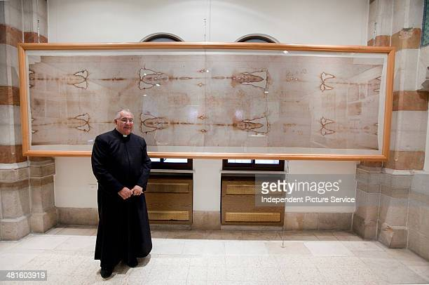 Roman Catholic Father Christopher in front of the Shroud of Turin a replica in the Notre Dame de France Hospice Jerusalem Israel
