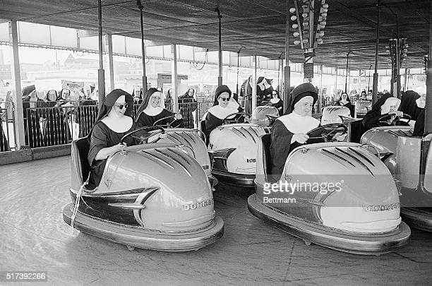 Roman Catholic Nuns get in a traffic jam on a bumper cars ride at the Chicago Free Fair sponsored by neighborhood merchants