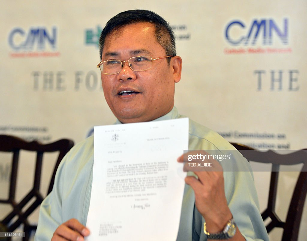 Roman Catholic priest Monsignor Joselito Asis, secretary-general of the influential Catholic Bishops Conference of the Philippines, shows the letter of the Vatican to the Papal nuncio to Manila on the resignation of Pope Benedict XVI during a press conference in Manila on February 12, 2013. People across the mainly Catholic Philippines feel regret, gratitude and sympathy after Pope Benedict XVI announced plans on February 11 to resign, a presidential spokesman said. The Catholic Church entered uncharted waters on February 12 after Pope Benedict XVI's shock announcement that he would become the first pontiff to resign of his own free will in 700 years. AFP PHOTO/TED ALJIBE