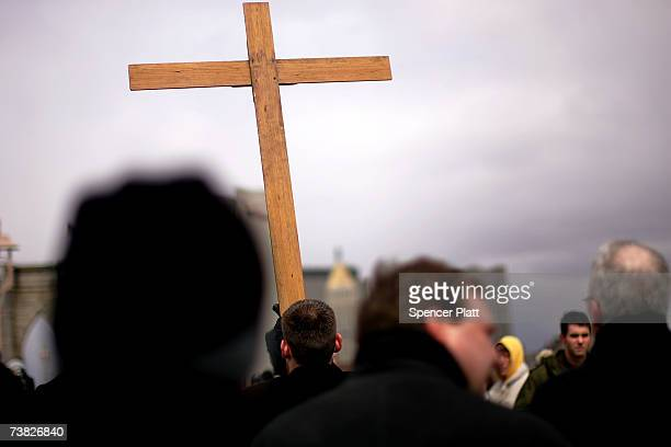 Roman Catholics participate in the twelfth annual Way of the Cross procession across the Brooklyn Bridge on Good Friday April 6 2007 in New York City...